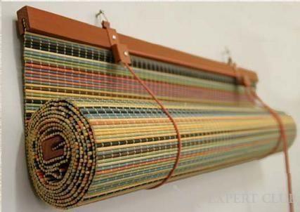 Механізм автоматичного згортання рулонної штори