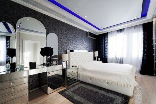 фото чорної спальні з білою ліжком